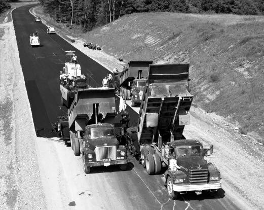diamond-T-and-two-International-Loadstars-in-Hartland--Vermont-during-Interstate-91-paving-September-1966