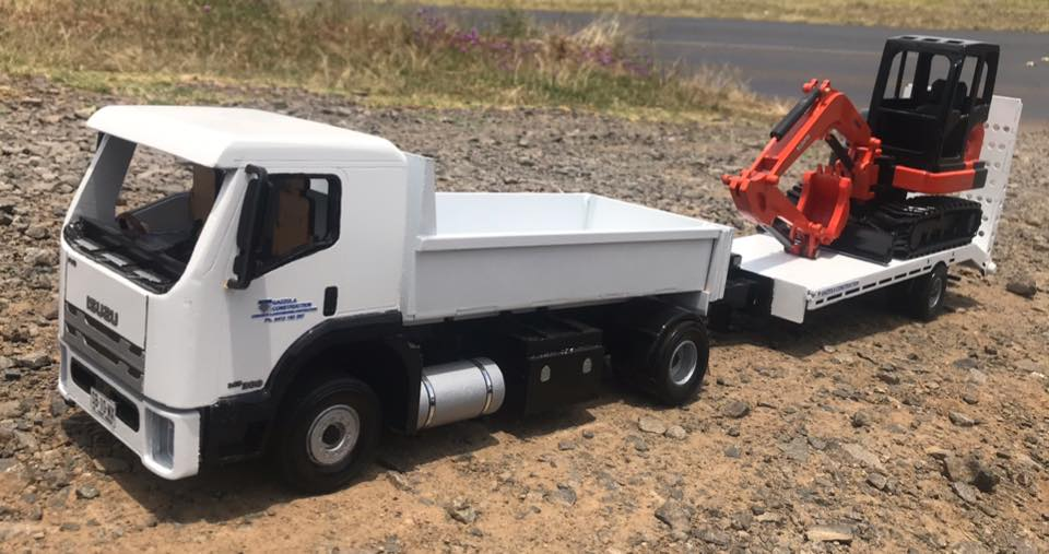 Isuzu-Tipper-and-tag-trailer-with-a-Kubota-mini-digger-3