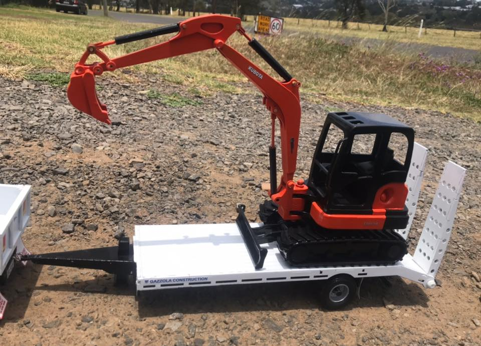 Isuzu-Tipper-and-tag-trailer-with-a-Kubota-mini-digger-5