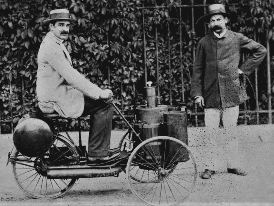 Albert-de-Dion,-on-a-steam-tricycle--with-Georges-Bouton-in-1887