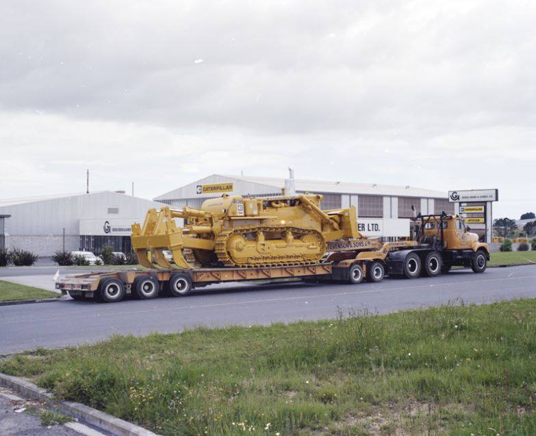 Stevenson-taking-delivery-of-Cat-D9H-SN9OV1766-in-1975-heading-to-Kopuka-set-up-with-push-blade-1