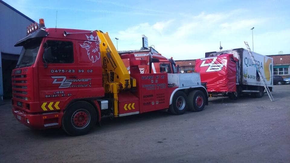 Scania-in-Herstal-een-schadewagen-ophalen-
