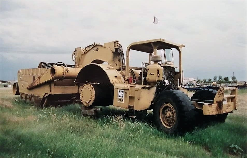Michael-Hubert-Chicopee-A-field-of-Cat-666660650-scrapers-I-photographed-in-Wyoming-back-in-2000-They-were-owned-by-Osbourne-Bros-construction-1