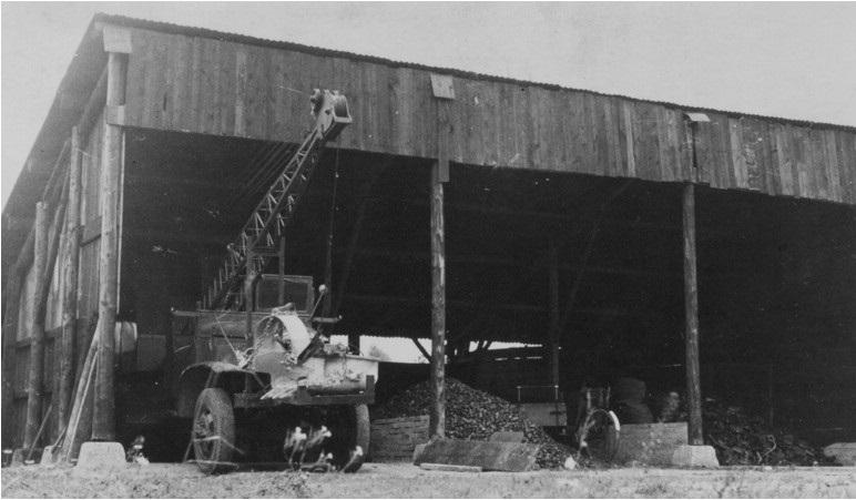 5-GMC-met-FUCHS-dragline-in-de-kolenloods-aan-de-Heijerstraat