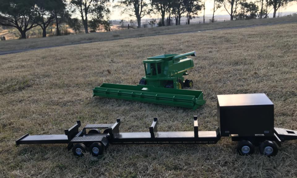 Wooden-model-of-a-John-Deere-9770--with-a-Midwest-comb-trailer-3