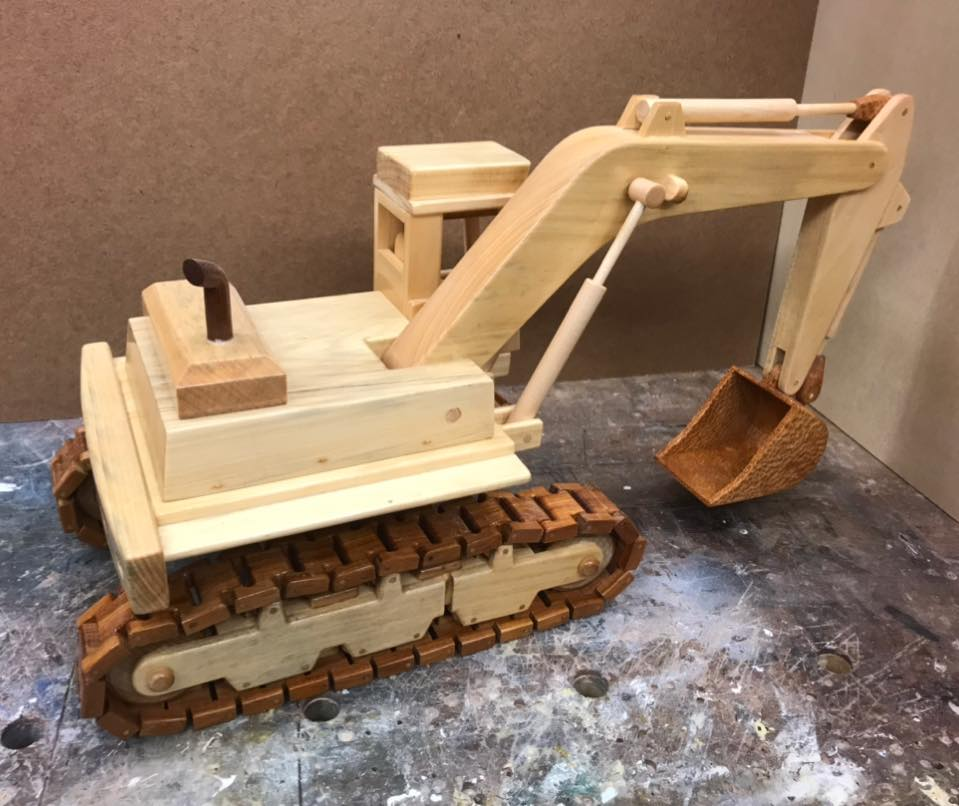 a-wooden-model-of-an-excavator-3