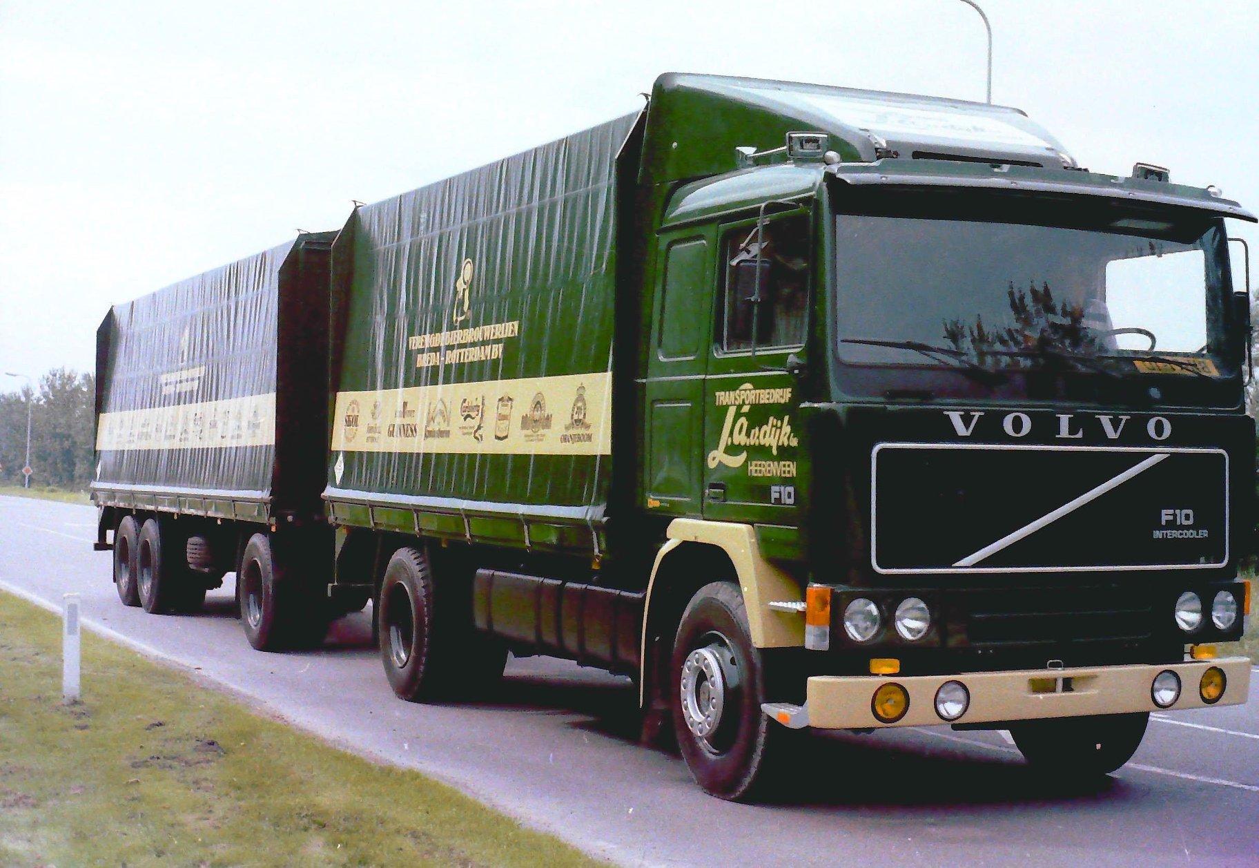 Volvo-F10-met-rolkleden-met-een-RAF-tandemas-aanhangwagen-met-rolkleden-is-van-Transportbedrijf-L-van-Dijk-BV-uit-Heerenveen