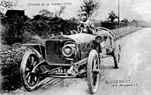 1906-Albert_Clement_driving_a_Clement-Bayard_at_the_French_Grand_Prix